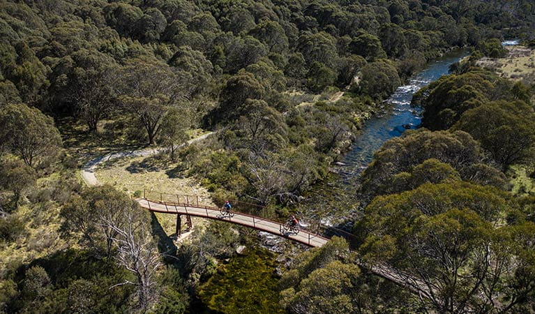 Aerial view of suspension Bridge 4 over Thredbo River, along Thredbo Valley track in Kosciuszko National Park. Photo: Robert Mulally/DPIE