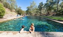 Visitors swim in the thermal pool, Yarrangobilly area of Kosciuszko National Park. Photo: Boen Ferguson/OEH.