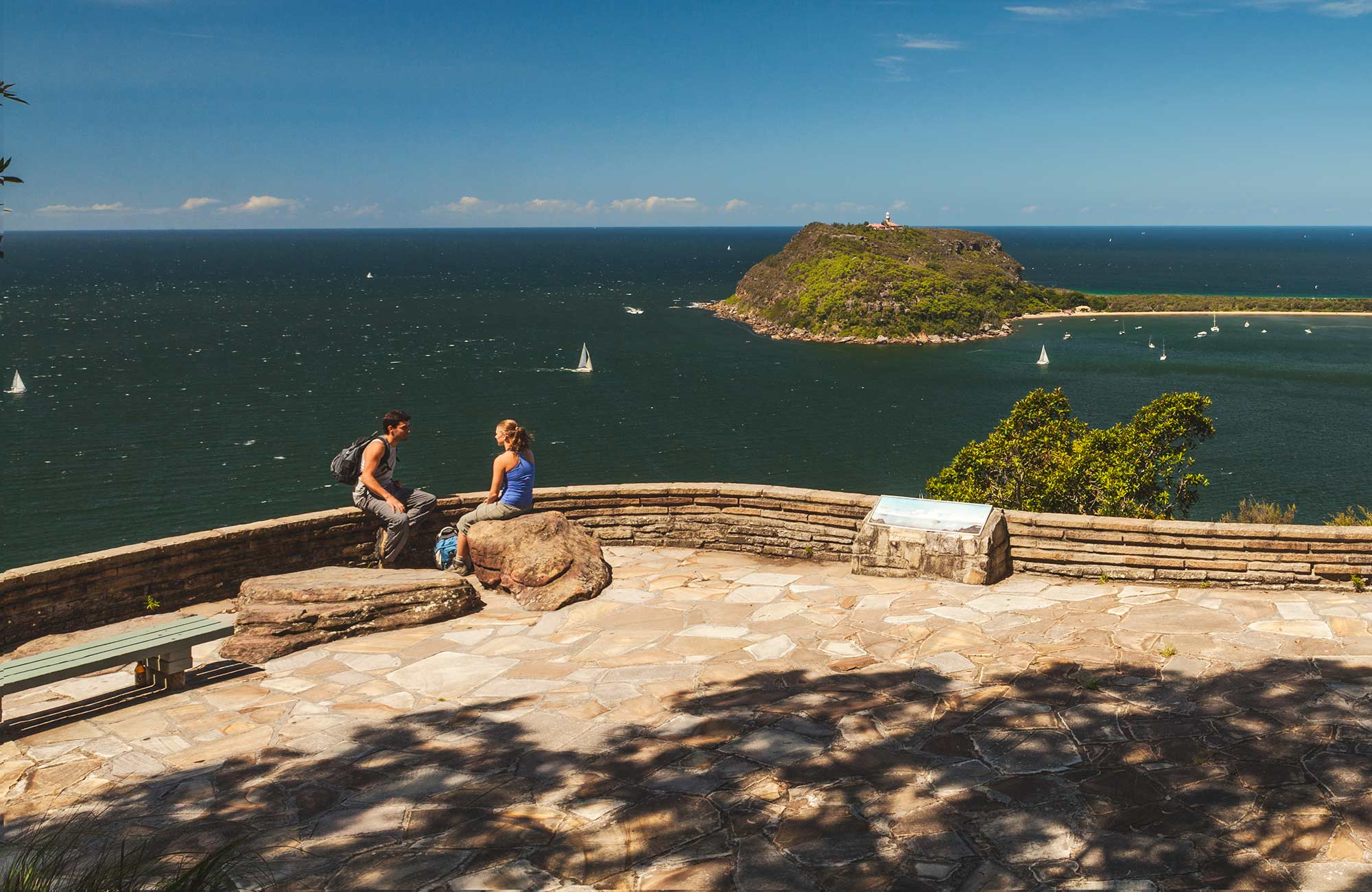 People enjoying the view out to sea from West Head lookout. Photo:David Finnegan