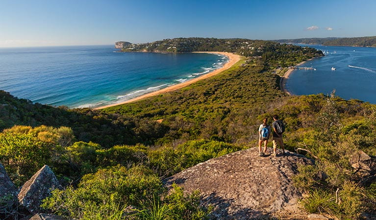 Two people walking to Barrenjoey Lighthouse, admiring coastal views over Ku-ring-gai Chase National Park. Photo: David Finnegan/OEH