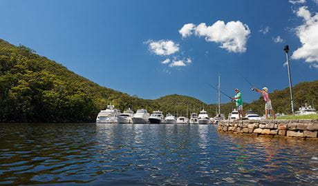 A father and son go fishing next to a marina at Bobbin Head in Ku-ring-gai Chase National Park. Photo: David Finnegan/OEH