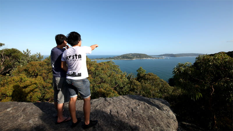 Two people enjoying West Head lookout at Ku-ring-gai Chase National Park. Photo: Andy Richards