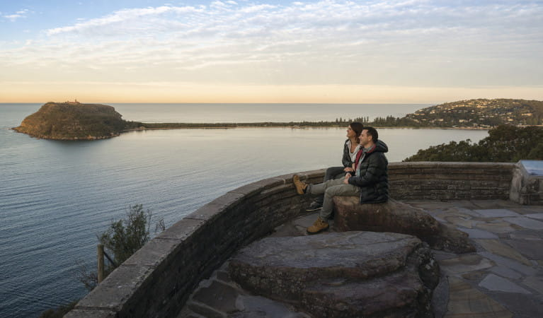 A couple enjoys the view at West Head lookout in Ku-ring-gai Chase National Park. Photo: John Spencer/OEH