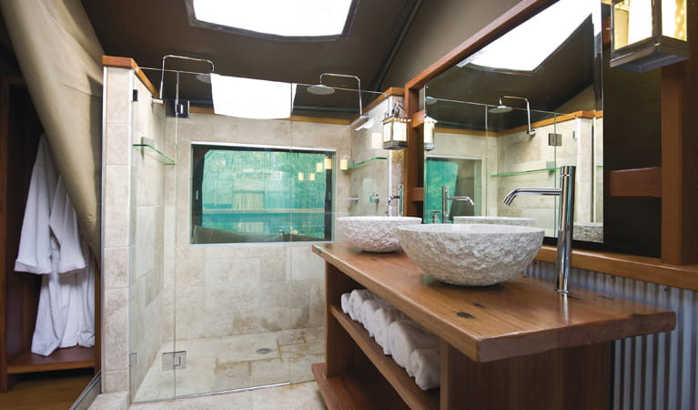 The luxurious bathroom at Lane Cove Holiday Park - Tandara, with a double shower and comfortable robes. Photo: OEH
