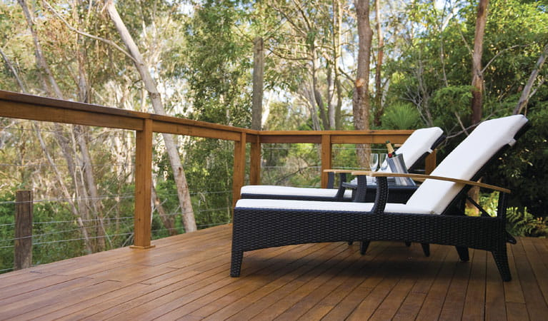 Two deck chairs on the balcony of Lane Cove Holiday Park - Tandara, overlooking the bushland. Photo: OEH