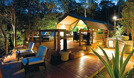 Views of a luxurious tent at Lane Cove Holiday Park - Tandara, lit up at night. Photo: OEH