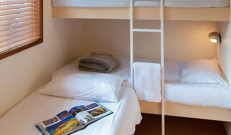 Bedroom with bunk beds and a single bed at Lane Cove Holiday Park – cabins, Lane Cove National Park. Photo: Bob Fowler