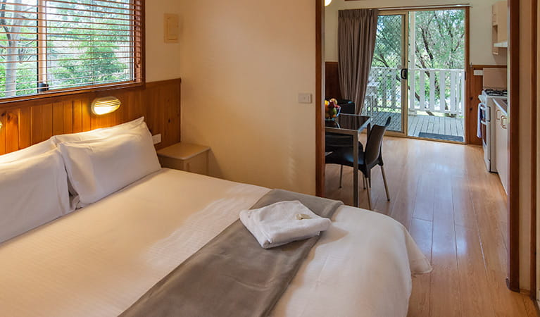 Master bedroom with views of kitchen and dining area at Lane Cove Holiday Park – cabins. Photo: Bob Fowler