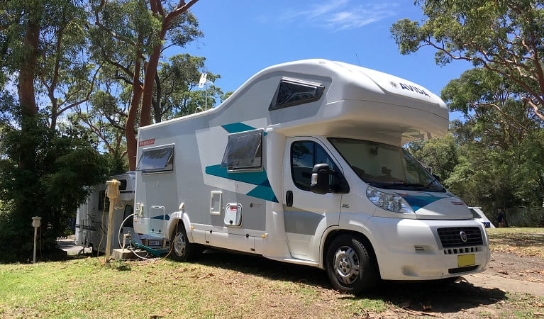 A powered motorhome parked at Lane Cove Holiday Park - caravan park, in Lane Cove National Park. Photo: Claire Franklin/OEH