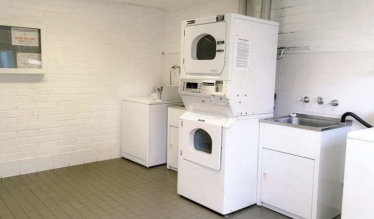 Washing machines and dryers in the laundry Lane Cove Holiday Park - caravan park, Lane Cove National Park. Photo: Claire Franklin/OEH