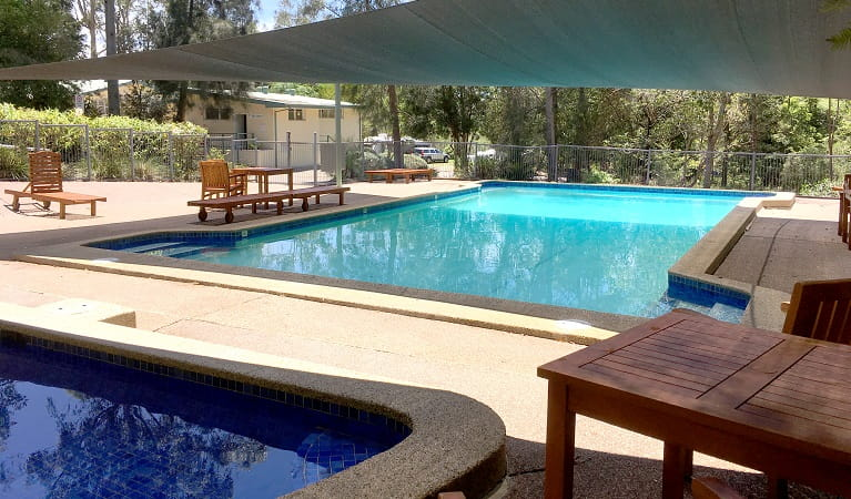 The shaded swimming pools, deck chairs and picnic tables at Lane Cove Holiday Park - caravan park, Lane Cove National Park. Photo: Claire Franklin/OEH