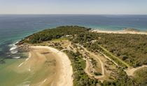 An aerial photo of Point Plomer campground and nearby beach in Limeburners Creek National Park. Photo: John Spencer/OEH
