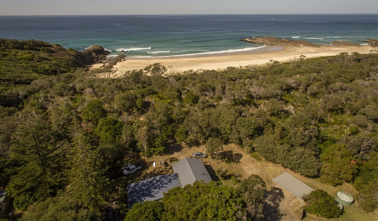 An aerial photo of Plomer Beach House and coastal views at Limeburners Creek National Park. Photo: John Spencer/OEH