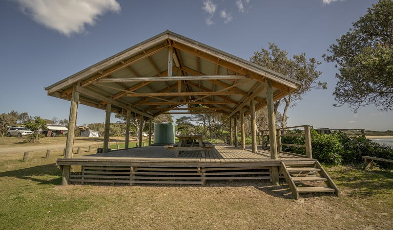 Picnic tables with large shelter at Point Plomer campground, Limeburners Creek National Park. Photo: John Spencer/OEH