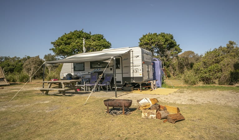Caravan parked on site at Point Plomer campground, Limeburners Creek National Park. Photo: John Spencer/OEH