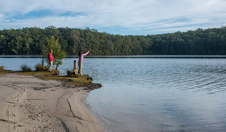 Couple fishing on Burrill Lake, Giriwa walking track, Meroo National Park. Photo: Michael Van Ewijk/OEH