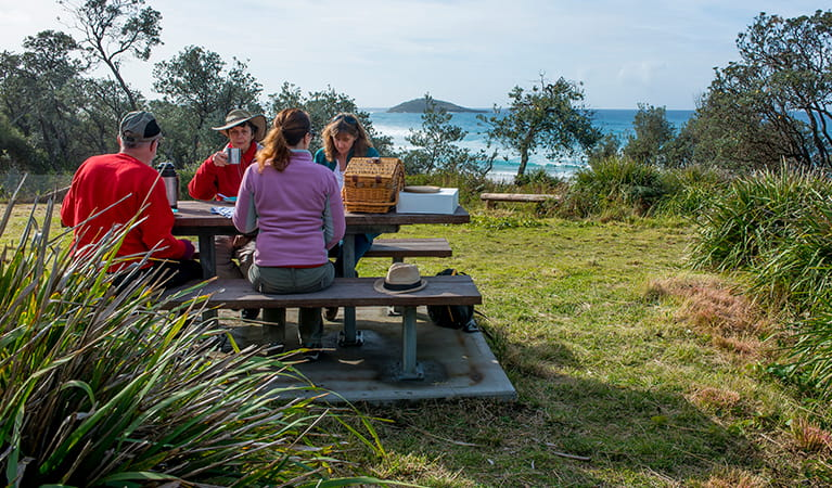 People having lunch at Stokes Island picnic area, Meroo National Park. Photo: Michael van Ewijk/OEH