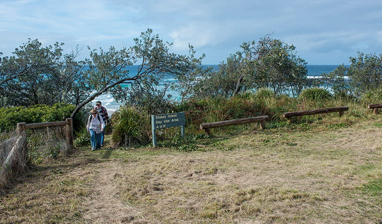 People walking up from the beach at Stokes picnic area, Meroo National Park. Photo: Michael van Ewijk/OEH