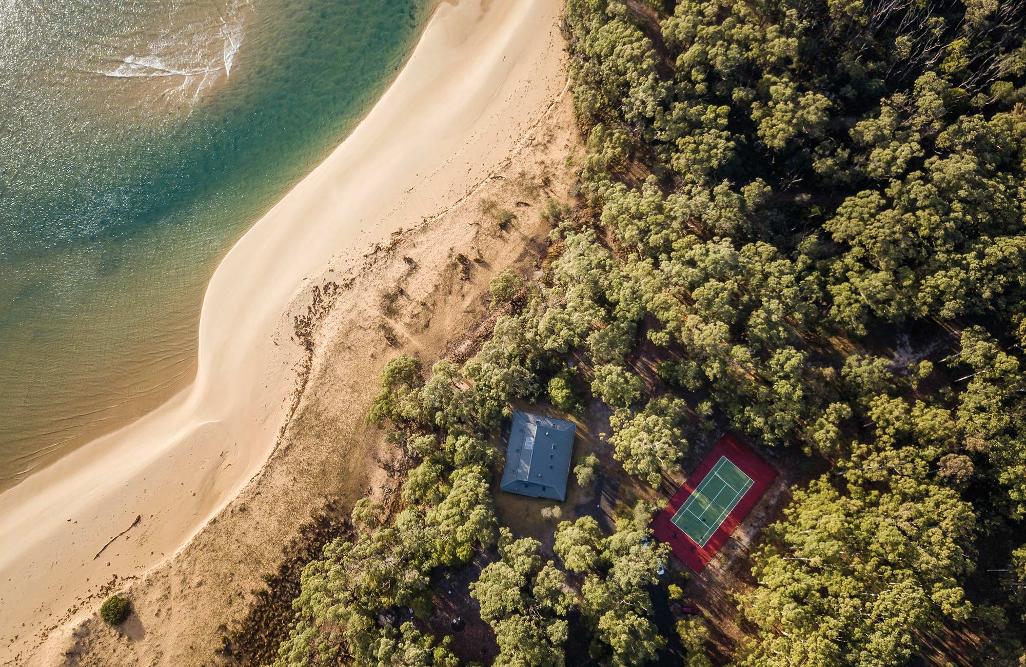 Aerial view of Myer House next to the beach in Mimosa Rocks National Park. Photo: John Spencer/DPIE