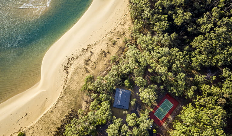 Ariel view of Myer House, tennis court and beach at Mimosa Rocks National Park. Photo: OEH/John Spencer