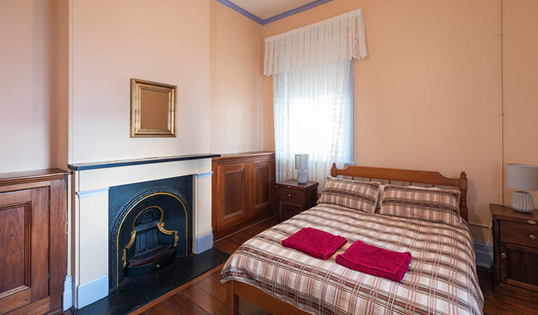 Double bedroom with old fireplace in Montague Island Assistant Lighthouse Keepers Cottage. Photo: Daniel Tran/OEH