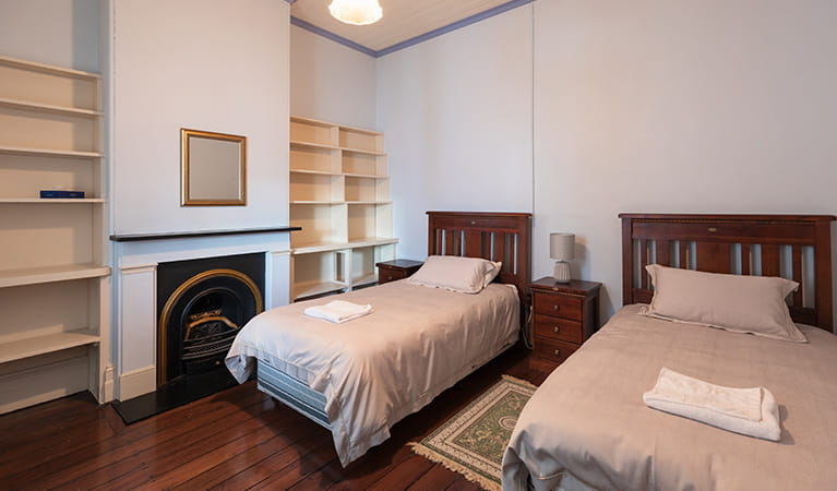 Twin beds in bedroom at Montague Island Assistant Lighthouse Keepers Cottage. Photo: Daniel Tran/OEH