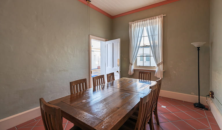 8-seat dining table in Montague Island Assistant Lighthouse Keepers Cottage. Photo: Daniel Tran/OEH