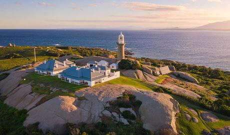 Aerial view of Montague Island lighthouse and cottage at sunset. Photo: Daniel Tran/OEH
