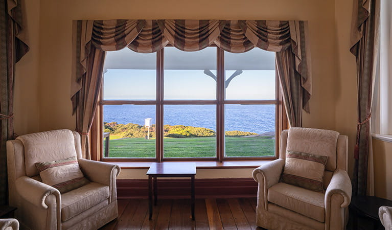 2 armchairs and window views from the lounge at Montague Island Lighthouse Keepers Cottage. Photo: Daniel Tran/OEH