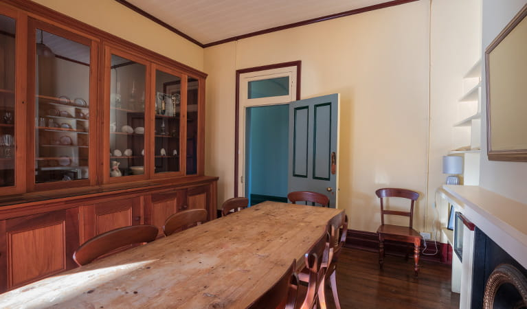 Dining table and cabinet in the dining room of Montague Island Head Lighthouse Keepers Cottage. Photo: Daniel Tran/OEH