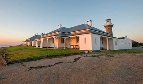 Montague Island lighthouse keepers' cottages at sunrise. Photo: Justin Gilligan.
