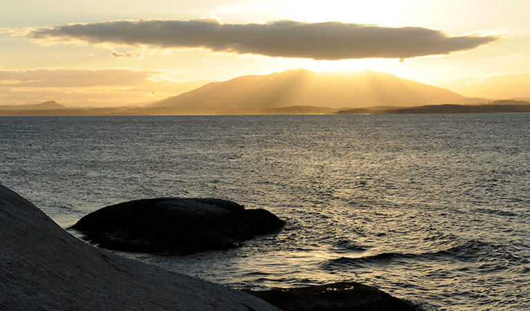 View of sunset over Gulaga mountain, near Narooma, seen from Montague Island. Photo: Stuart Cohen/OEH