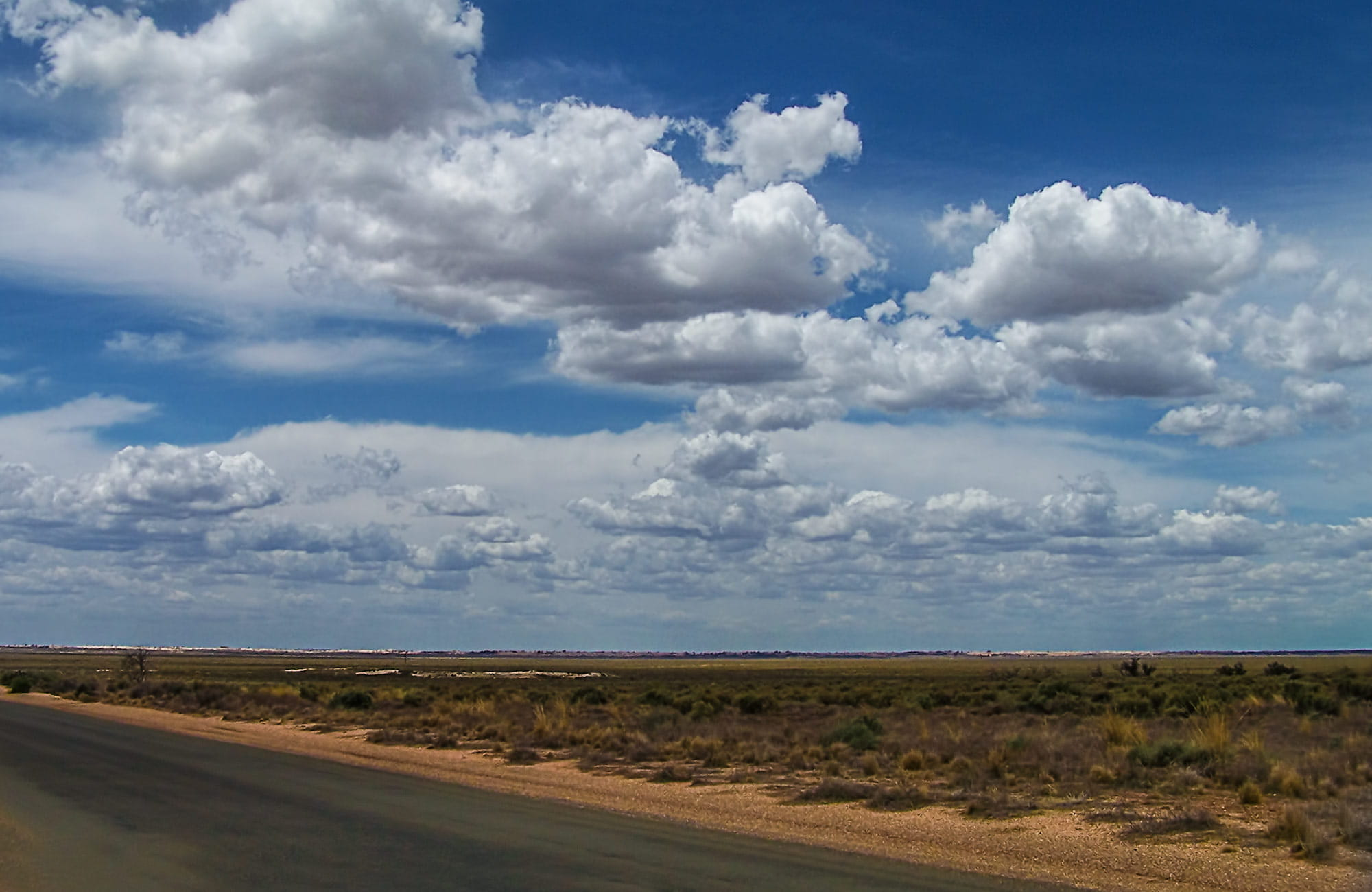 Long outback road with a big sky, Mungo National Park. Photo:OEH