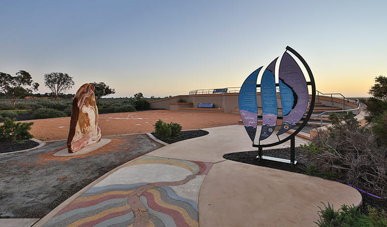 Interpretive signs and art displays outside Mungo Visitor Centre in Mungo National Park. Vision House Photography/OEH