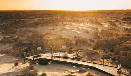 Two girls stand at Red Top lookout boardwalk, Mungo National Park. Photo: Melissa Findley/OEH