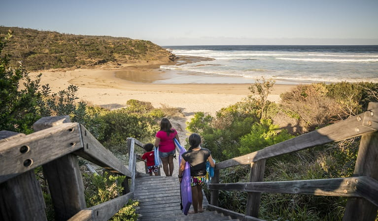 A family walking downstairs to Frazer beach, Munmorah State Conservation Area. Photo: John Spencer/OEH
