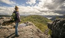 Woman standing at Point Loop lookout, Muogamarra Nature Reserve. Photo: John Spencer/DPIE