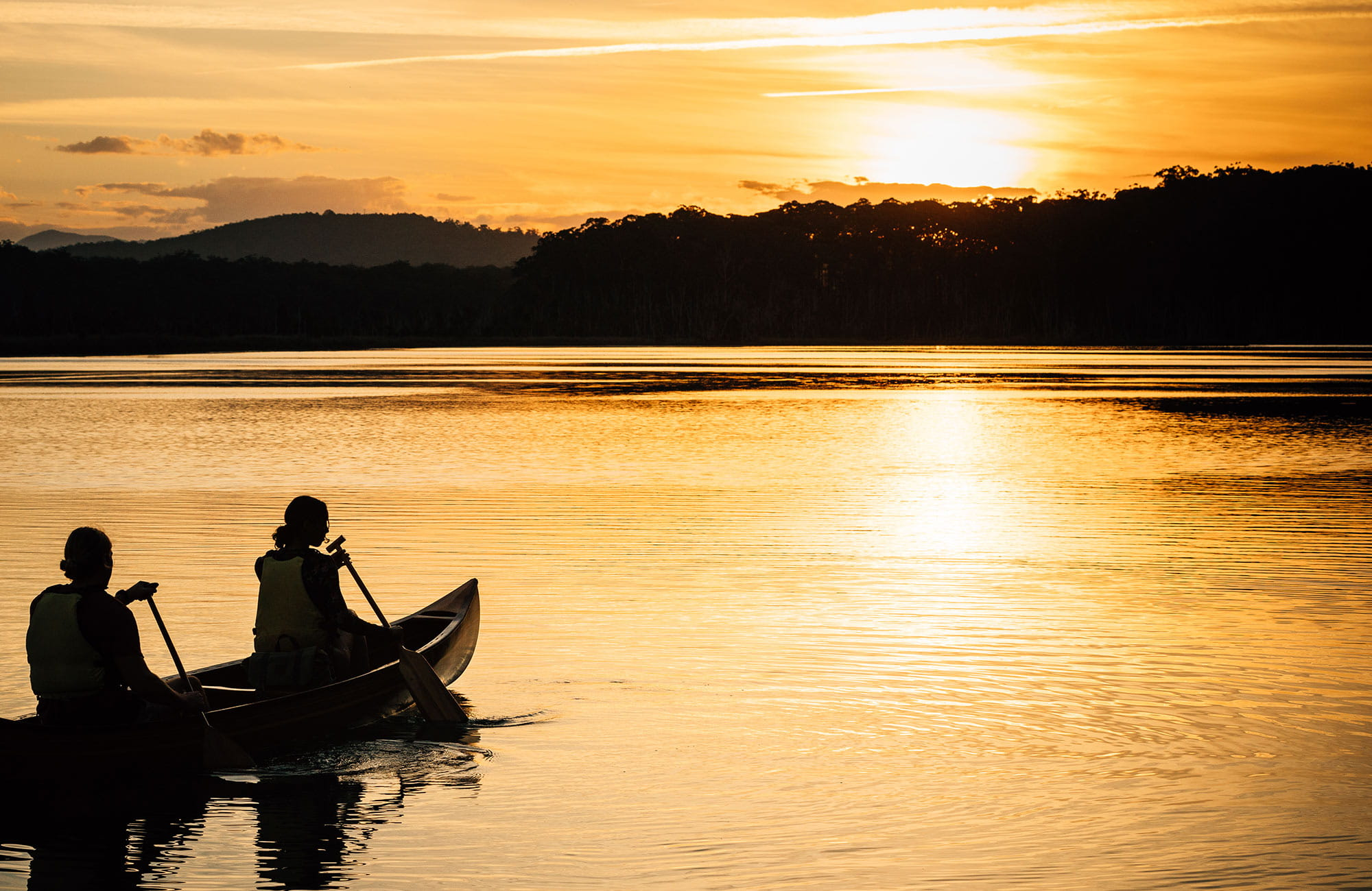 Kayakers on Durras Lake at sunset, Murramarang National Park. Photo: Melissa Findley/OEH.