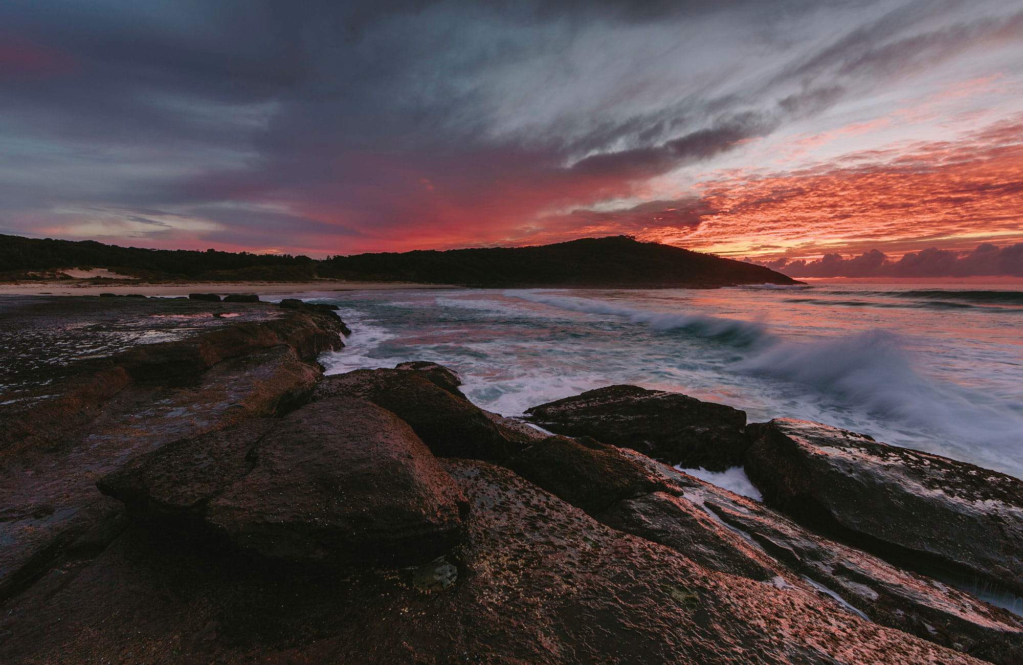 Sun setting across Pretty beach, Murramarang National Park. Photo: D Finnegan/OEH
