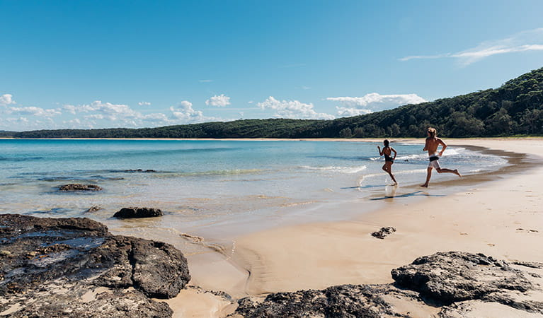A couple at North Durras Beach, Burrawang walking track, Murramarang National Park. Photo: Melissa Findley/OEH.