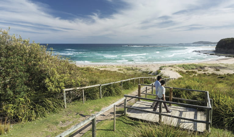 Couple enjoying views over Pretty Beach on the NSW South Coast. Photo credit: David Finnegan ©DPIE
