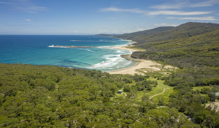 Aerial shot of Pretty Beach and picnic area in Murramarang National Park. Photo: John Spencer/DPIE