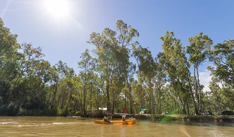 Paddlers pass by Swifts Creek campground, Murray Valley National Park. Photo: B Ferguson/OEH