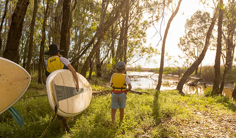 Paddlers take their gear to the shore of Barmah Lake, Barmah National Park. Photo: B Ferguson/OEH
