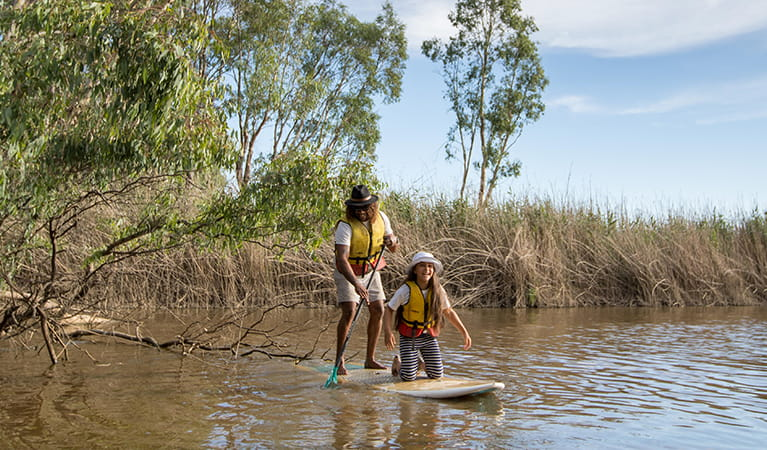 Dad and daughter share a stand up paddleboard on the Murray River. Photo: B Ferguson/OEH