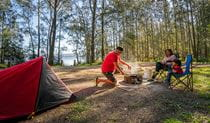 Campers cooking up a storm at Bungarie Bay campground. Photo: John Spencer/OEH