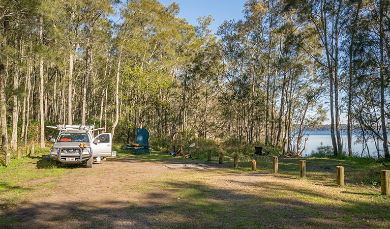 Campers setting up for their stay at Bungarie Bay campground. Photo: John Spencer/OEH