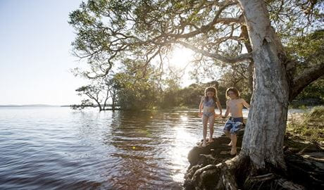 Children playing by the lake, Myall Lakes National Park. Photo: Nolan Verheij-Full