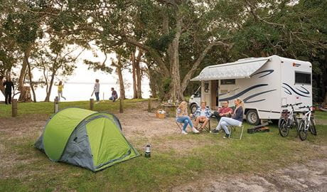 A group of friends sitting beside their campervan at Mungo Brush campground. Photo: John Spencer/OEH