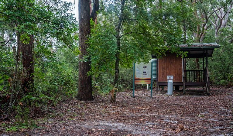 View of toilet block set in a sandy clearing surrounded by trees. Photo: John Spencer © DPIE